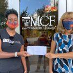 Nierda accepts grant check from Joan